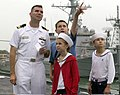 US Navy 051012-N-2736O-002 Lt. Patrick S. Joyner stands on the forecastle with his family members prior to getting underway for a friends and family day cruise aboard the guided missile destroyer USS Barry (DDG 52).jpg
