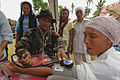 US Navy 060529-N-6501M-044 A member of the Philippine Army checks vital signs of a local Filipino woman as she participates in a Medical Civil Action Program (MEDCAP).jpg