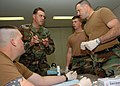 US Navy 070130-N-0775Y-002 ospital Corpsman 2nd Class Steven East explains how to prepare an intravenous needle to Senior Chief Construction Mechanic Richard Rhoads as part of a Combat Life Saver course at Camp Shields, Okinawa.jpg