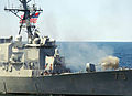 US Navy 070406-N-5345W-098 Arleigh Burke-class guided missile destroyer USS Oscar Austin (DDG 79) fires her 5-inch gun during a gunfire demonstration as she transits alongside Nimitz-class aircraft carrier USS Harry S. Truman (.jpg
