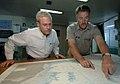 US Navy 070904-N-0194K-174 Capt. Ed Nanartowich, ship master of Military Sealift Command hospital ship USNS Comfort (T-AH 20), shows a navigational sea chart to Stephen Johnson, the Deputy Assistant Secretary of Defense for Wes.jpg