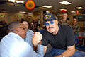 US Navy 071102-N-2468S-001 Professional wrestling champion Sgt. Slaughter arm-wrestles with Builder Constructionman Recruit Lars Triggs.jpg