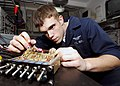 US Navy 071106-N-8132M-026 Aviation Electronics Technician Airman Gregory Hardin troubleshoots an aviation inter-phone communicator using a multimeter aboard nuclear-powered aircraft carrier USS Enterprise (CVN 65).jpg