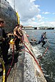US Navy 080810-N-8933S-082 Navy Diver 1st Class Michael Linzy jumps off the former Soviet submarine-urned museum, Juliett 484. The submarine sank at her mooring point in about 30 feet of water after a nor'easter struck Providen.jpg