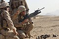US Navy 081024-M-9389C-099 Hospital Corpsmen 3rd Class Joshua S. Hall, left, the 2nd squad corpsmen of 1st platoon, Fox Company, 2nd Battalion 7th Marine Regiment, guides Staff Sergeant Brian J. Johnson on to target.jpg