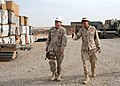 US Navy 090506-N-9410R-122 Builder 2nd Class Scott Hampton, assigned to Naval Mobile Construction Battalion (NMCB) 5, gives Capt. Jeff Borowy, commander of the 25th Navy Construction Regiment (NCR), a tour of the Material Liais.jpg