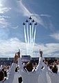 US Navy 090522-N-0593C-034 Members of the U.S. Naval Academy Class of 2009 cheer as the Navy's Blue Angels flight demonstration team perform the traditional fly-over at Navy-Marine Corps Memorial Stadium.jpg
