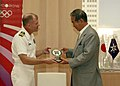 US Navy 090828-N-8487G-052 Capt. Gregory J. Fenton, commanding officer of the amphibious transport dock ship USS Denver (LPD 9), presents a ship's plaque to Tokyo Metropolitan Governor Shintaro Ishihara while discussing an upco.jpg