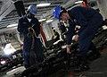 US Navy 091016-N-3830J-150 eaman Robert Chittenden and Seaman Raymond Lovelace lock the anchor chain.jpg
