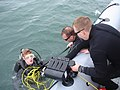 US Navy 100125-N-3301D-014 Sailors attending Navy Explosive Ordnance Disposal (EOD) School assist Seaman Andrew King from the water after an underwater search mission in the Gulf of Mexico.jpg