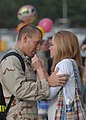 US Navy 100607-N-9520G-004 Aviation Electronic Technician 2nd Class John Corcel is welcomed by his wife during a homecoming at Naval Air Station Whidbey Island.jpg