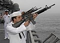 US Navy 100610-N-8283S-046 A rifle squad from the amphibious assault ship USS Boxer (LHD 4) fire a 21-gun salute during a burial at sea.jpg