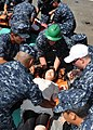 US Navy 100829-N-3620B-002 Stretcher-bearers and members of the Medical Training Team prepare to move victims to a safe location during a simulated mass casualty drill aboard the amphibious transport dock ship USS Denver (LPD 9.jpg
