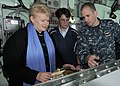 US Navy 100921-N-0982V-019 President of Lithuania Dalia Grybauskaite, left, operates the helm of the amphibious command ship USS Mount Whitney (LCC.jpg