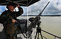 US Navy 101111-N-7589W-109 Master-at-Arms Seaman Gregory Seigmund stands aft watch aboard High Speed Vessel Swift (HSV 2) during its transit throu.jpg