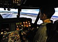 US Navy 110621-N-DX615-028 Midshipman 3rd Class Juan Vielma pilots a helicopter simulator while learning about the various job opportunities for pr.jpg