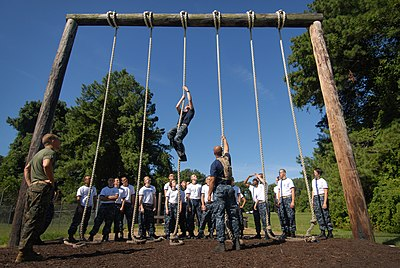 US Navy 110714-N-OA833-003 Plebes in the U.S. Naval Academy Class of 2015 receive rope climbing instruction at the school's obstacle course