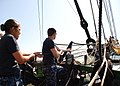 US Navy 110715-N-AU127-226 Sailors assigned to USS Constitution heave a line during sail training aboard Friendship of Salem.jpg