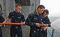 US Navy 111010-N-MW330-032 nformation Systems Technician Seaman Zachary Crowell, left, Seaman Apprentice Christopher Gonzalez, and Seaman Brooke Ha.jpg