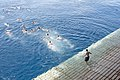US Navy 111125-N-BJ752-106 Sailors and Marines aboard the multi-purpose amphibious assault ship USS Essex (LHD 2) participate in a swim call.jpg