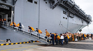 US Navy 111212-N-FH966-001 Sailors and Marines move mail onto the amphibious assault ship USS Makin Island.jpg