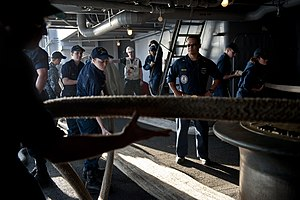 US Navy 111227-N-BT887-069 Sailors heave mooring lines during sea and anchor detail aboard the Nimitz-class aircraft carrier USS John C. Stennis (C.jpg