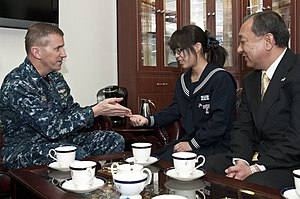 US Navy 120205-N-II118-002 A CO presents a command coin to a visitor of the ship.jpg