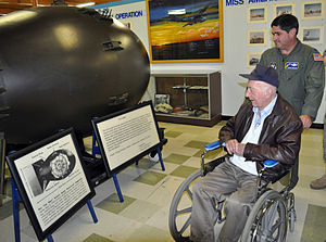 Travis Air Force Base Heritage Center - Veteran Col. Barrett Broussard browses a Fat Man atomic bomb replica at an exhibit inside the museum