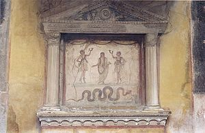 Tutelary deity - Lararium depicting tutelary deities of the house: the ancestral Genius (center) flanked by two Lares, with a guardian serpent below