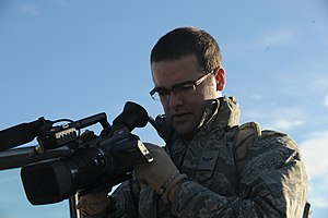 Videographer - U.S. Air Force Airman Daniel Johnson performs a function check on his video camera before shooting.