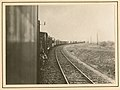 View of railroad tracks and train (8659284416).jpg