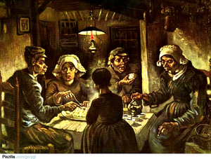 Two men and three women eating potatoes.
