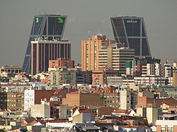 Pairtial view o the Tetuán destrict. In the backgrund, the Puerta de Europa [1] inclined biggins