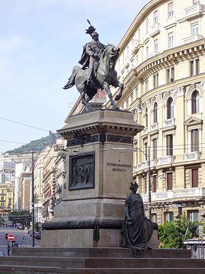 Tommaso Solari - Monument to Vittorio Emanuele II (equestrian statue by Alfonso Balzico, scenes at base by Solari) in Piazza Bovio, Naples.