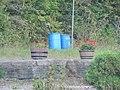 Water barrels and Geranium planters (6171569703).jpg
