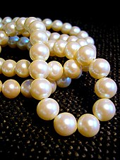 collier perle signification
