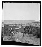 Woman and child outside town LOC matpc.11549.jpg