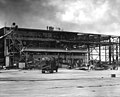Wrecked hangar at NAS Ford Island with OS2Us 1941.jpg