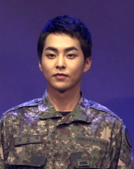 "Xiumin during the musical ""The Promise of the Day"", in September 2019.png"