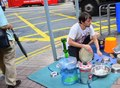 File:Street performer playing with household items near Wan Chai MTR station, Hong Kong.webm