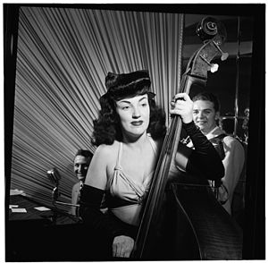 Sub-bass - Double bass player Vivien Garry playing a show in New York City in 1947. The double bass is the sub-bass instrument of the orchestral strings family, as it produces the pitches in the lowest register for this family.