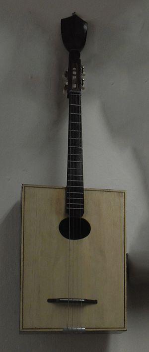 Đàn tứ - Modern Đàn tứ with rectangular body and longer neck