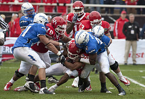 L. J. Castile - Castile is tackled during a game against Air Force.