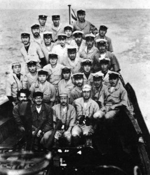 German submarine U-180 - Netaji Subhas Chandra Bose, Second left, first line and his Adjutant, Abid Hasan far left with the Crewmembers of I-29 after the exchange with U-180 (April 18, 1943)