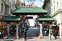 A Gateway Arch (Dragon Gate) on Grant Avenue at Bush Street in Chinatown, the only authentic Chinatown Gate in North America. Unlike similar structures which usually stand on wooden pillars, this iconic symbol conforms to Chinese gateway standards using stone from base to top and green-tiled roofs in addition to wood as basic building materials. The Gateway was designed by Clayton Lee, Melvin H. Lee and Joe Yee in 1970.[1]