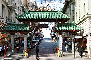 History of Chinese Americans in San Francisco - The Gateway Arch (Dragon Gate) on Grant Avenue at Bush Street in Chinatown.