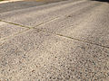 2014-08-29 15 33 50 Closeup of pavement along Stuyvesant Avenue in Ewing, New Jersey, with concrete pavement likely dating to the 1950s.JPG