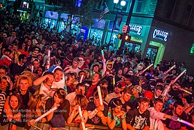 photo of large crowd in multiple costumes gathered in front of a stage during halloween 2015 in athens ohio