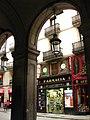 352 El carrer Ferran des dels porxos del pge. Madoz.jpg