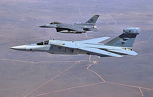430th Electronic Combat Squadron - General Dynamics EF-111A Raven (EF-31) 67-037 with Cannon-based F-16 524th TFS.jpg